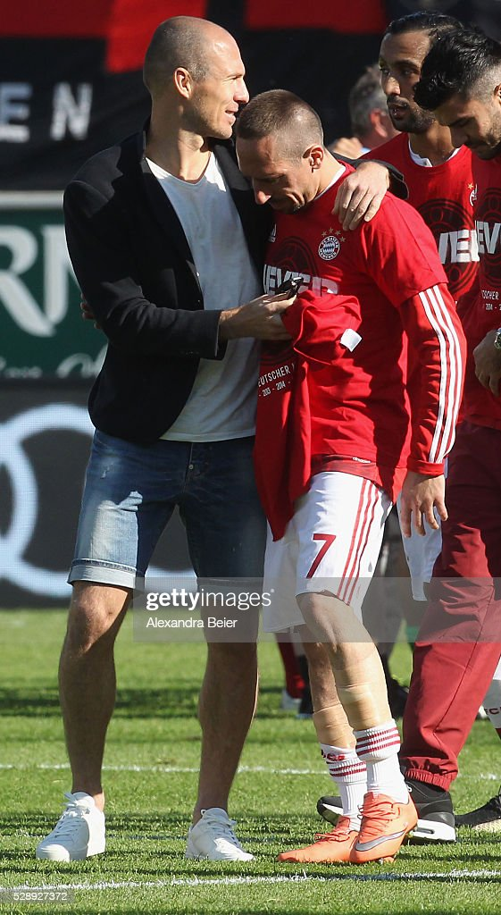 Arjen Robben (L) and Franck Ribery of Bayern Muenchen celebrate their German Championship title after the Bundesliga match between FC Bayern Muenchen and FC Ingolstadt at Audi Sportpark on May 7, 2016 in Ingolstadt, Germany.