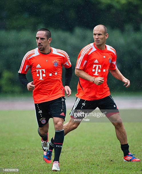 Arjen Robben and Franck Ribery of Bayern Muenchen in action during a training session ahead the friendly match against VfL Wolfsburg as part of the...