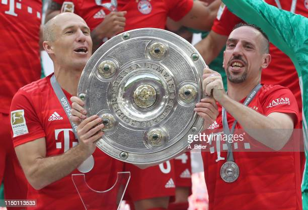 Arjen Robben and Franck Ribery of FC Bayern Muenchen celebrate the German Championship title after the Bundesliga match between FC Bayern Muenchen...