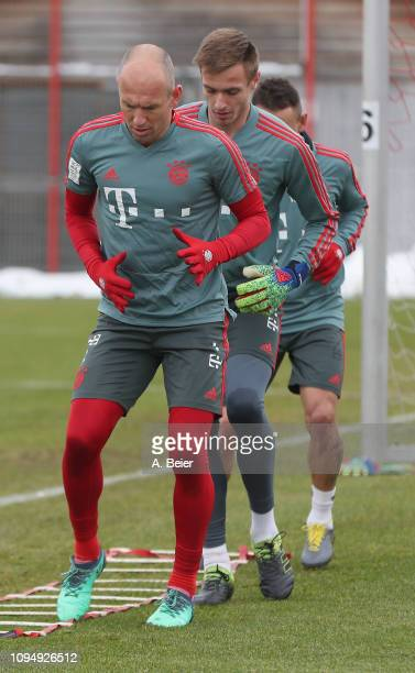 Arjen Robben and goalkeeper Christian Fruechtl of FC Bayern Muenchen practice during a training session at the club's Saebener Strasse training...