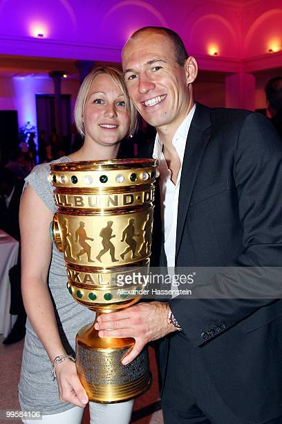 Arjen Robben and his wife Bernadien pose with the trophy during the Bayern Muenchen Champions Party after the DFB Cup Final match against Werder...