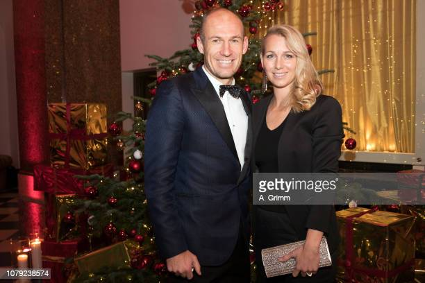 Arjen Robben and his wife Bernadien Robben arrive for the FC Bayern Muenchen Christmas Party at Palais Lenbach on December 08 2018 in Munich Germany
