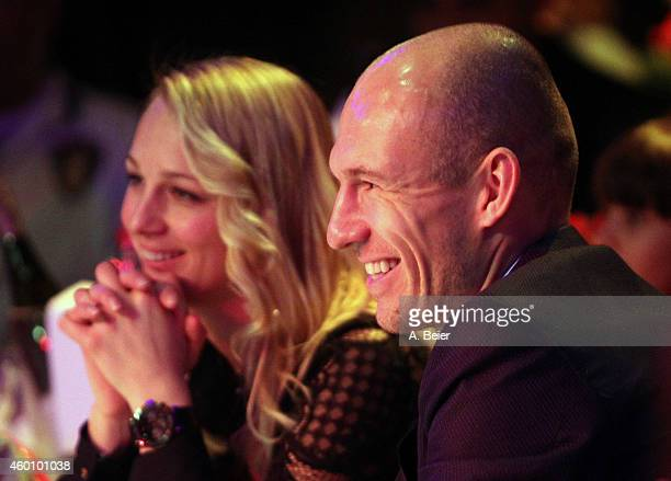 Arjen Robben and his wife Bernadien Robben attend the FC Bayern Muenchen christmas party at Schuhbeck's Teatro restaurant on December 7 2014 in...