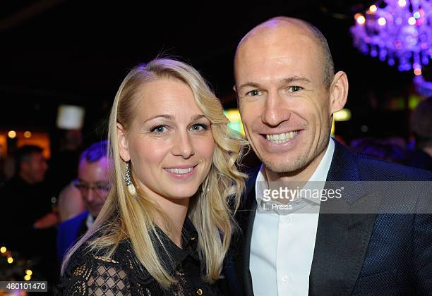 Arjen Robben and his wife Bernadien Robben attend the FC Bayern Muenchen Christmas Party at Schubeck's Teatro restaurant on December 7, 2014 in...