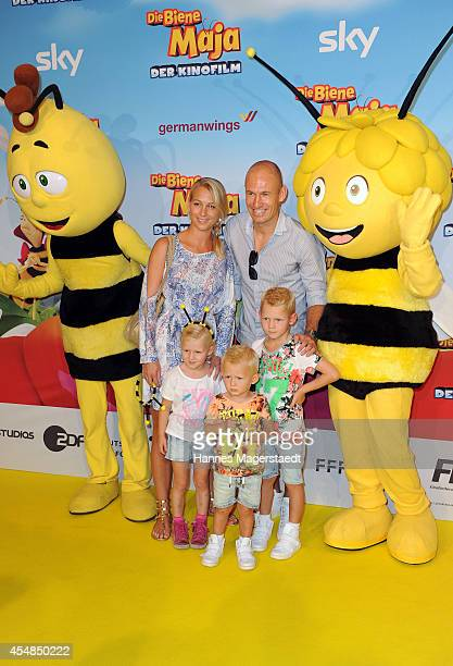 Arjen Robben and his wife Bernadien with their kids Lynn Luka and Kai attend the German premiere of the film 'Die Biene Maja Der Kinofilm' at...