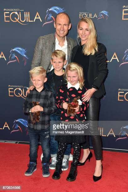 Arjen Robben and his wife Bernadien with their kids Lynn, Luka and Kai during the world premiere of the horse show 'EQUILA' at Apassionata Showpalast...