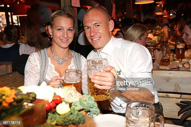 Arjen Robben and his wife Bernadine Robben during the Oktoberfest 2015 at Theresienwiese on Oktober 03 2015 in Munich Germany