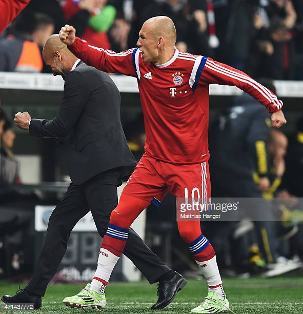 Arjen Robben and Josep Guardiola head coach of Muenchen celebrate the first goal during the DFB Cup semi final match between FC Bayern Muenchen and...