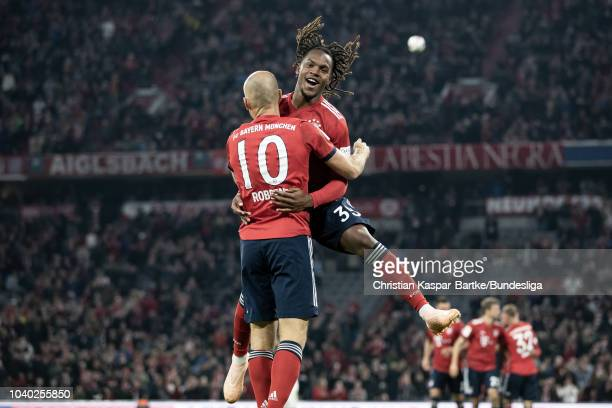 Arjen Robben and Renato Sanchez celebrate the opening goal for Munich during the Bundesliga match between FC Bayern Muenchen and FC Augsburg at...