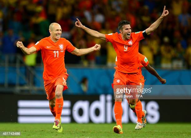Arjen Robben and Robin van Persie of the Netherlands celebrate the win after the penalty shootout in the 2014 FIFA World Cup Brazil Quarter Final...