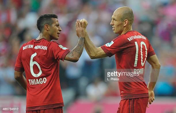 Arjen Robben and Thiago Alcantara of FC Bayern Muenchen celebrate scoring their team's third goal during the Bundesliga match between FC Bayern...