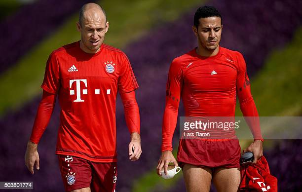 Arjen Robben and Thiago are seen during a training session at day two of the Bayern Muenchen training camp at Aspire Academy on January 7 2016 in...