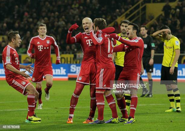 Arjen Robben and Thiago of FC Bayern congratulate Mario Gotze of FC Bayern after his goal during the Bundesliga match between FC Bayern and Bor...