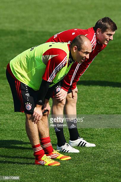 Arjen Robben and Toni Kroos look on during a training session of Bayern Muenchen at the ASPIRE Academy for Sports Excellence on January 6 2012 in...