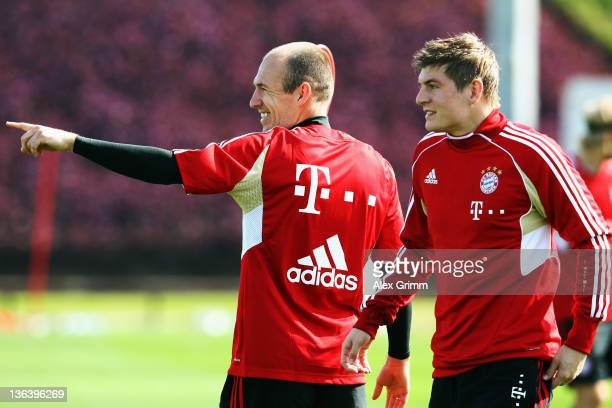 Arjen Robben and Toni Kroos react during a training session of Bayern Muenchen at the ASPIRE Academy for Sports Excellence on January 4 2012 in Doha...
