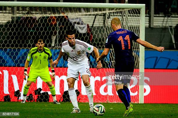 Arjen Robben attacks watched by Cesar Azpilicueta and Iker Casillas at the 2014 World Cup match between Spain and Netherlands in Salvador Brasil this...