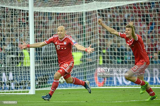 Arjen Robben celebrates after scoring Bayern Muenchen's winning goal during the UEFA Champions League final match between Borussia Dortmund and FC...