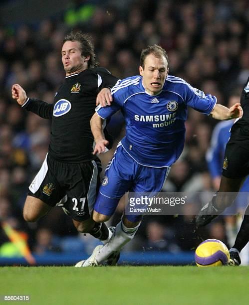 Arjen Robben Chelsea and Kristofer Haestad Wigan Athletic battle for the ball