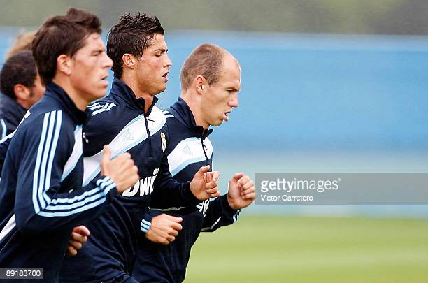 Arjen Robben Cristiano Ronaldo and Agus of Real Madrid run during a training session on July 22 2009 in Dublin Ireland