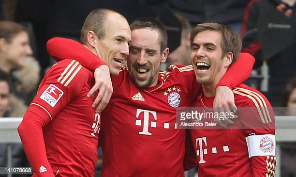 Arjen Robben Franck Ribery and Philipp Lahm of Bayern Muenchen celebrate Bayern's seventh goal during the Bundesliga match between FC Bayern Muenchen...