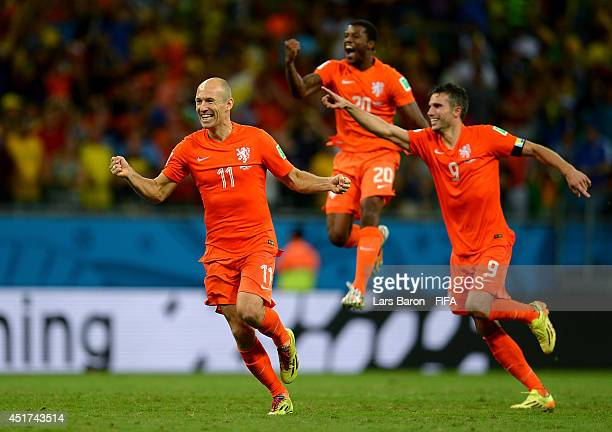 Arjen Robben Georginio Wijnaldum and Robin van Persie of the Netherlands celebrate the win after the penalty shootout in the 2014 FIFA World Cup...