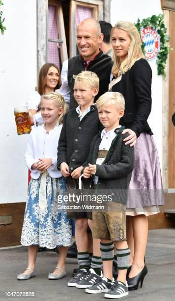 Arjen Robben, his wife Bernadien Robben and their children Lynn Robben, Luka Robben and Kai Robben attend the Oktoberfest beer festival at Kaefer...