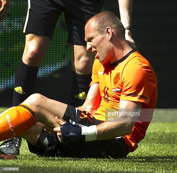 Arjen Robben holds his thigh after injuring himself during a friendly international football match against Hungary on June 5 2010 Robben is a doubt...