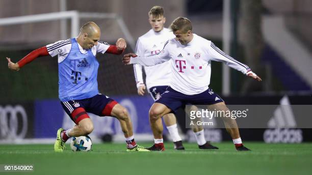 Arjen Robben is challenged by Niklas Dorsch during a training session on day 4 of the FC Bayern Muenchen training camp at ASPIRE Academy for Sports...