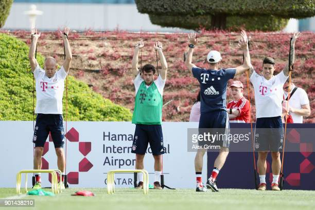 Arjen Robben Juan Bernat and James Rodriguez exercise during a training session on day 4 of the FC Bayern Muenchen training camp at ASPIRE Academy...