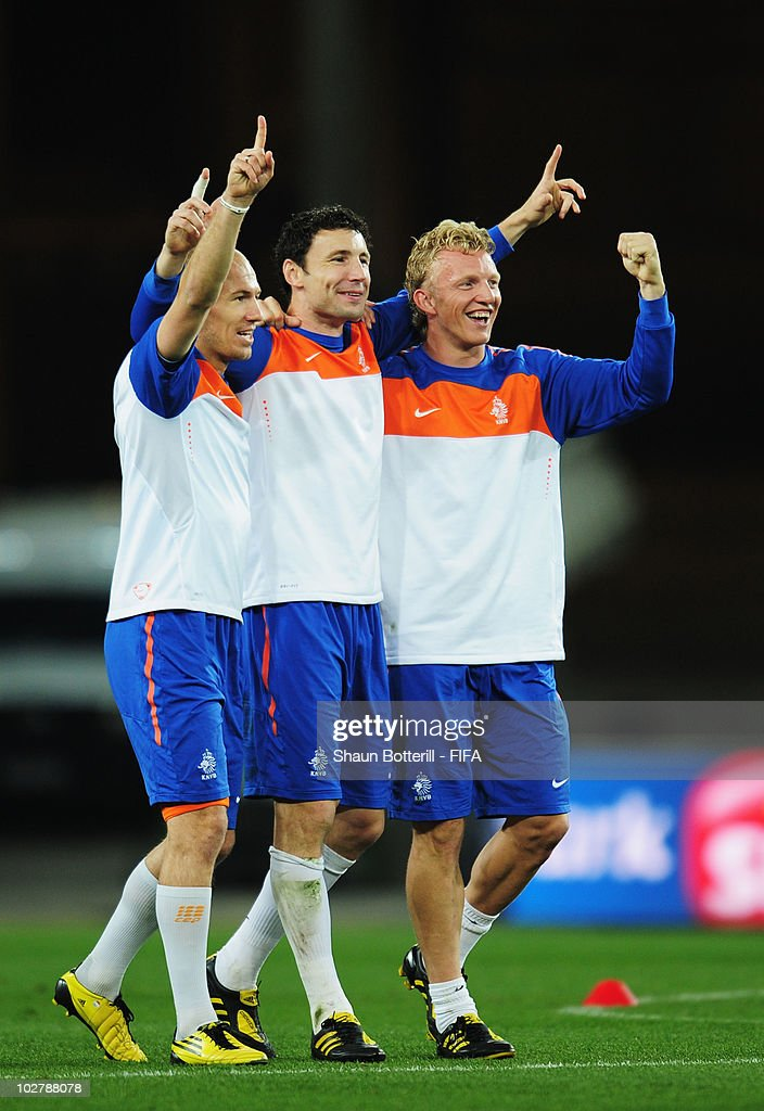 Arjen Robben, Mark Van Bommel and Dirk Kuyt of the Netherlands celebrate during a Netherlands training session, ahead of the 2010 FIFA World Cup Final, at Soccer City Stadium on July 10, 2010 in Johannesburg, South Africa.