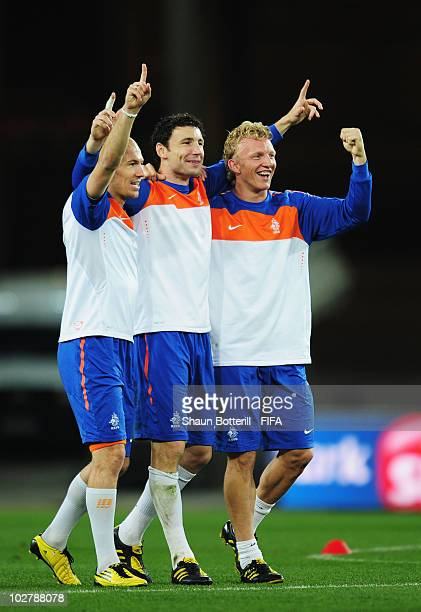 Arjen Robben Mark Van Bommel and Dirk Kuyt of the Netherlands celebrate during a Netherlands training session ahead of the 2010 FIFA World Cup Final...