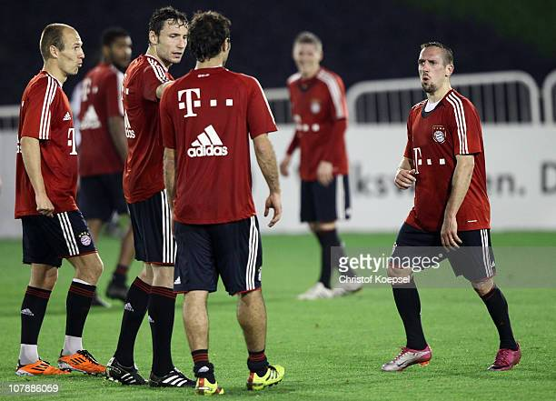 Arjen Robben Mark van Bommel Hamit Altintop and Franck Ribery of Bayern attend the FC Bayern Muenchen training session at Aspire Academy for Sports...