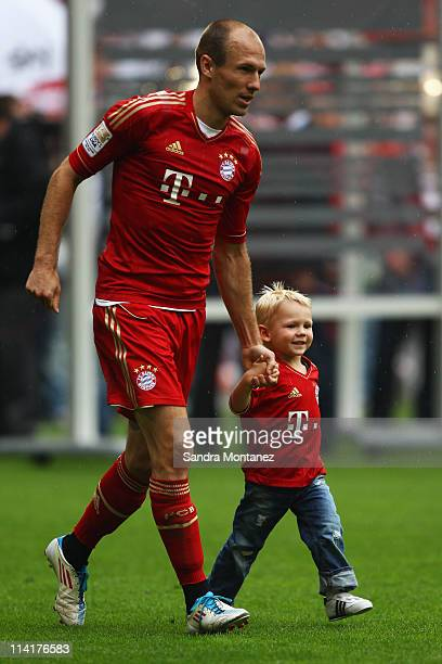 Arjen Robben of Bayern and his son Luka celebrate their victory in the Bundesliga match between FC Bayern Muenchen and VfB Stuttgart at Allianz Arena...