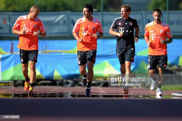 Arjen Robben of Bayern and teammates Diego Contento and Claudio Pizarro as well as fitness coach Andreas Kornmeier run during day two of the Bayern...