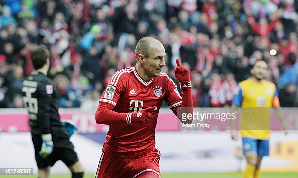 Arjen Robben of Bayern celebrates after heading in a goal during the Bundesliga match between Bayern Muenchen and Eintracht Braunschweig at Allianz...