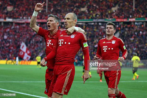Arjen Robben of Bayern celebrates the first goal with Bastian Schweinsteiger and Toni Kroos during the DFB Cup final match between Borussia Dortmund...