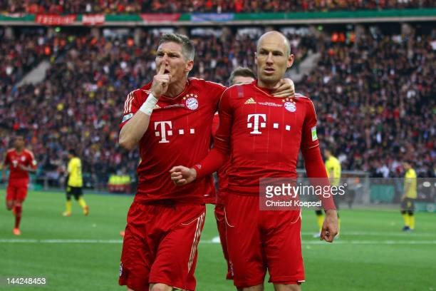 Arjen Robben of Bayern celebrates the first goal with Bastian Schweinsteiger during the DFB Cup final match between Borussia Dortmund and FC Bayern...