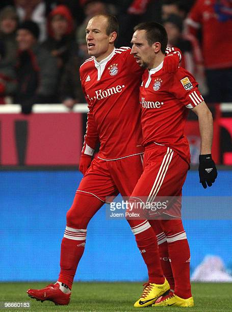 Arjen Robben of Bayern celebrates with his team mate Frank Ribery after scoring his team's second goal during the Bundesliga match between FC Bayern...