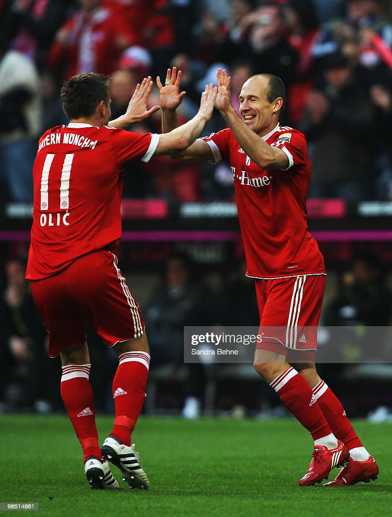 Arjen Robben of Bayern celebrates with his team mate Ivica Olic (L) after scoring the fifth goal during the Bundesliga match between FC Bayern Muenchen and Hannover 96 at Allianz Arena on April 17, 2010, in Munich, Germany.
