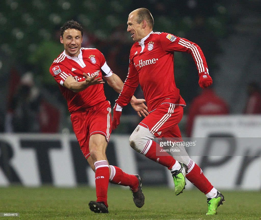 Arjen Robben of Bayern celebrates with his team mate Mark van Bommel after scoring his team's third goal during the Bundesliga match between Werder Bremen and FC Bayern Muenchen at Weser Stadium on January 23, 2010 in Bremen, Germany.