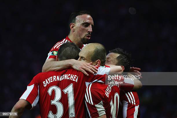 Arjen Robben of Bayern celebrates with team mates after scoring the opening goal through a penalty during the DFB Cup final match between SV Werder...
