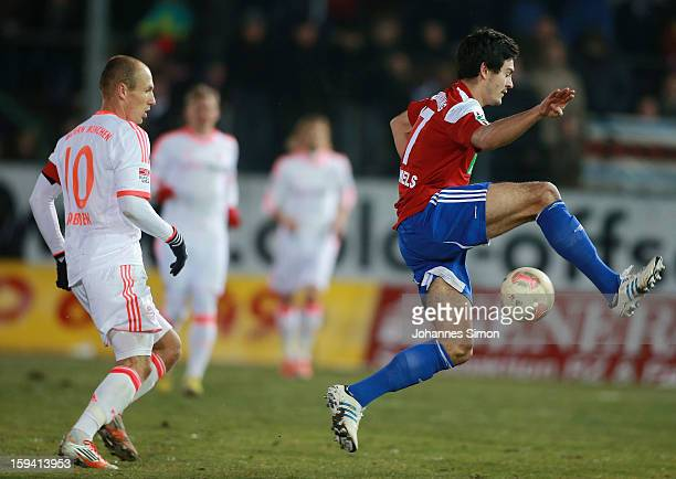 Arjen Robben of Bayern fights for the ball with Jonas Hummels of Unterhaching during the friendly game between FC Bayern Munich and SpVgg...