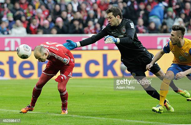 Arjen Robben of Bayern heads in a goal during the Bundesliga match between Bayern Muenchen and Eintracht Braunschweig at Allianz Arena on November 30...