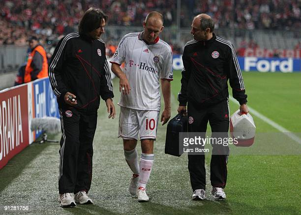 Arjen Robben of Bayern leaves the pitch after picking an injury during the UEFA Champions League Group A match between FC Bayern Muenchen and...