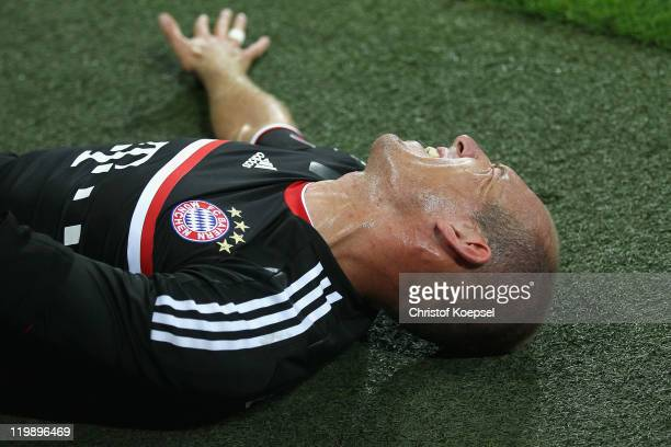Arjen Robben of Bayern lies injured on the pitch during the Audi Cup match between FC Bayern Muenchen and AC Milan at Allianz Arena on July 26 2011...