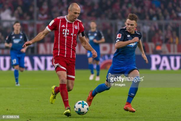 Arjen Robben of Bayern Muenchen and Dennis Geiger of Hoffenheim battle for the ball during the Bundesliga match between FC Bayern Muenchen and TSG...
