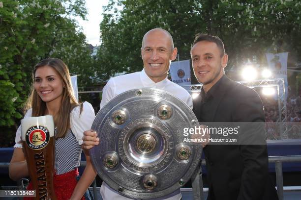 Arjen Robben of Bayern Muenchen and his team mate Rafinha celebrate winning the German Championship title during the Fanfest at Paulaner am...