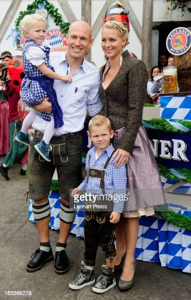 Arjen Robben of Bayern Muenchen and his wife Bernadien Robben attend the Oktoberfest 2013 beer festival at Kaefers Wiesenschaenke on October 6 2013...