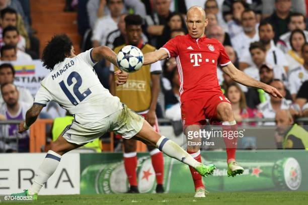 Arjen Robben of Bayern Muenchen and Marcelo of Real Madrid compete for the ball during the UEFA Champions League Quarter Final second leg match...