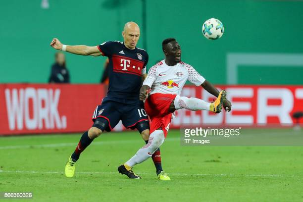 Arjen Robben of Bayern Muenchen and Naby Keita of Leipzig battle for the ball during the DFB Pokal soccer match between RB Leipzig and Bayern...